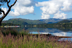 UK Lake District Ullswater Cumbria mountains blue sky white clouds Stock Images