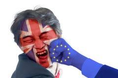 UK-mannen stansades i framsidan av EU, EU-begrepp för UK Brexit Arkivfoton