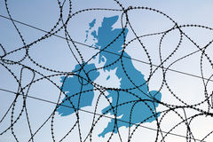 UK map behind barbed wire Royalty Free Stock Images