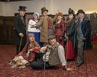 Reenactors in victorian costume prepare pose after their `travel. UK, Market Bosworth, Victorian Christmas Fair - December 2015:reenactors in victorian costume stock images