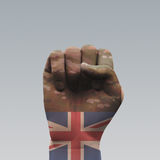 UK Miltitary. UK Flag Fist with Camouflage Stock Photo