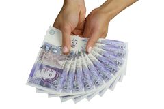 UK money british pounds. UK sterling money pounds in the hand Stock Images