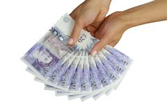UK money british pounds. UK sterling money pounds in the hand Stock Photography