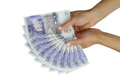 UK money british pounds. UK sterling money pounds in the hand Royalty Free Stock Photos