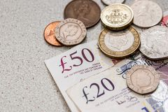 Uk money - coin and banknote stock images