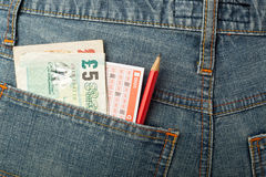 UK money and lottery bet slip in pocket Stock Photo