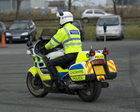 Uk Motorcycle Cop. Uk police motorcycle rider at the scene of a public disturbance Royalty Free Stock Photography