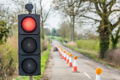 UK Motorway Roadworks Red Traffic Lights Cones Stock Photos