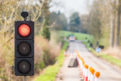 UK Motorway Roadworks Red Traffic Lights Cones Royalty Free Stock Photo