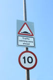 UK 10 mph speed limit and traffic calming speed bumps signs. UK traffic calming speed bumps and 10 mph speed limit signs royalty free stock photography