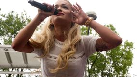 Rita Ora - UK 2014 music chart certified number 1. UK music chart certified number 1 platinum singer Rita Ora in a live outdoor performance in Washington DC Stock Images