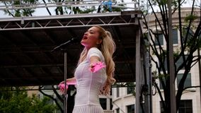 UK music chart certified number 1 platinum singer Rita Ora in a live outdoor performance in Washington DC last June 8, 2014 Royalty Free Stock Image