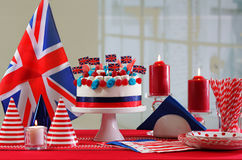 UK National holiday celebration party table. With showstopper cake and flags Royalty Free Stock Images