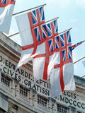 UK Naval Ensign. Close detail on the UK naval flag known as the white ensign on flagpoles atop Admiralty Arch, London Royalty Free Stock Photo