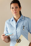 UK nurse holding prescription drug pack Royalty Free Stock Photos