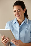 UK nurse using computer tablet Royalty Free Stock Photos