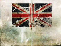 UK old flag on barred, closed door. Royalty Free Stock Photo