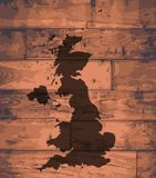 UK Map Brand. UK outline map brand on wooden board Stock Photo