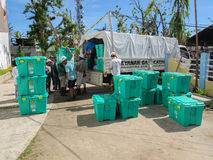 UK overseas aid workers loading ShelterBox emergency aid onto trucks Royalty Free Stock Photo