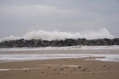 British coast being battered by winter storm. Erosion is a serious problem in Norfolk royalty free stock images
