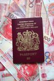 Uk passport. S on Chinese yuan and Hong Kong dollars Royalty Free Stock Images