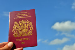 UK Passport and sky. UK passport held up to the sky Royalty Free Stock Photography