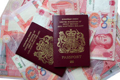Uk passports. On Chinese yuan Royalty Free Stock Photos