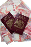 Uk passports. On Chinese yuan Royalty Free Stock Images