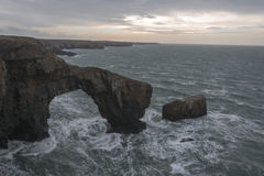 UK Pembrokeshire Green Bridge of Wales. UK Pembrokeshire green bridge on a windy day Royalty Free Stock Photo