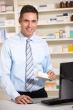 UK pharmacist at work Stock Images