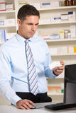 UK pharmacist working on computer Stock Image