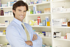 UK pharmacist working in pharmacy Royalty Free Stock Photo