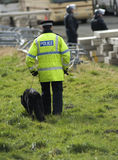 Uk Police Officer. S with a police dog at the scene of a public disturbance Royalty Free Stock Images