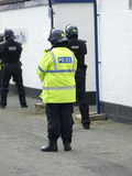 Uk Police Officers in Riot Gear. Uk police officers in full riot gear at the scene of a public disturbance Royalty Free Stock Photo