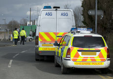 UK police vehicles. At the scene of a public disturbance Royalty Free Stock Photos