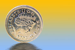 UK pound coin. Conceptual image showing pound coin over simulated water Stock Images