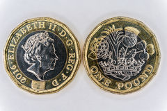 Uk pound coin. Front and rear image of the new UK twelve sided One pound coin royalty free stock image