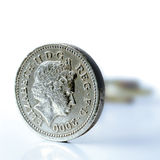 UK Pound Coin Macro. Studio macro image of a UK pound coin with blurred background. Copy space Royalty Free Stock Image