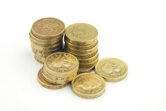 UK pound coins. Close-up of stack of UK pound coins on white Stock Photography