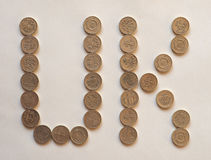 UK Pound coins, United Kingdom. UK written with One Pound coins money GBP, currency of United Kingdom Royalty Free Stock Photo