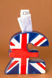 UK pound symbol piggy bank Stock Photos