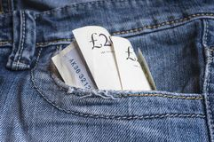 UK Pounds banknotes in blue denim pocket. Royalty Free Stock Photography