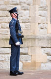 UK RAF soldier on guard. A sentry guard from the Royal Air Force (RAF) regiment on guard outside his London base Stock Image