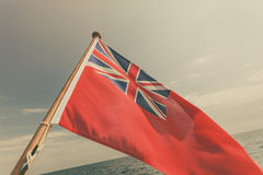Uk red ensign the british maritime flag flown from yacht Royalty Free Stock Image