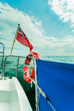 Uk red ensign the british maritime flag flown from yacht Stock Image