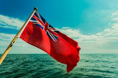 Uk red ensign the british maritime flag flown from yacht Stock Photography