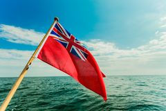 Uk red ensign the british maritime flag flown from yacht Stock Images