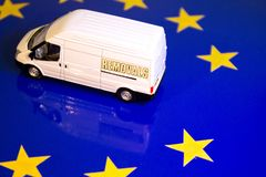 UK Removal From The EU Flag. A removals van on the EU flag to remove the UK's yellow star stock photos