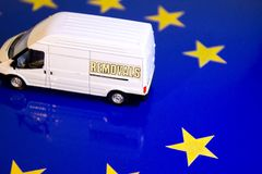 UK Removal From The EU Flag. A removals van on the EU flag to remove the UK's yellow star stock image
