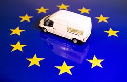 UK Removal From The EU Flag. A removals van on the EU flag to remove the UK's yellow star royalty free stock photo